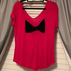 pink shirt with black bow on back